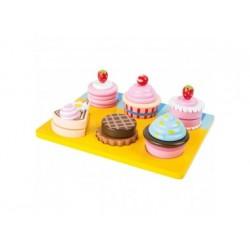 Schneide Cupcakes und Torten